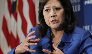 **FILE** Labor Secretary Hilda Solis speaks Aug. 30, 2011, at the National Press Club in Washington. (Associated Press)