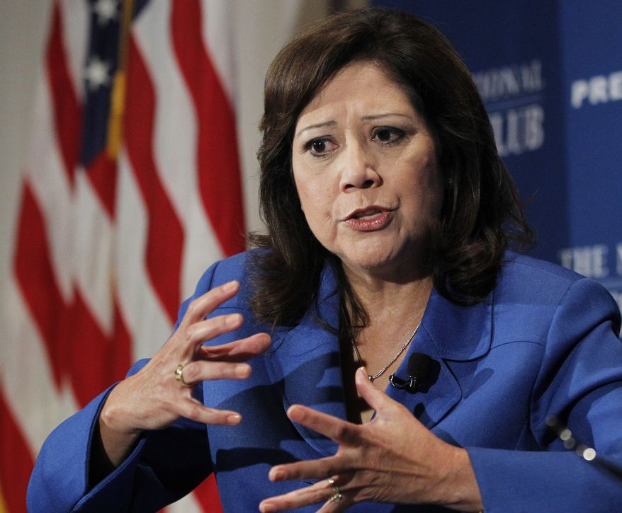 **FILE** Labor Secretary Hilda Solis speaks Aug. 30, 2011, at the National Press Club in Washington. (Associated Press)