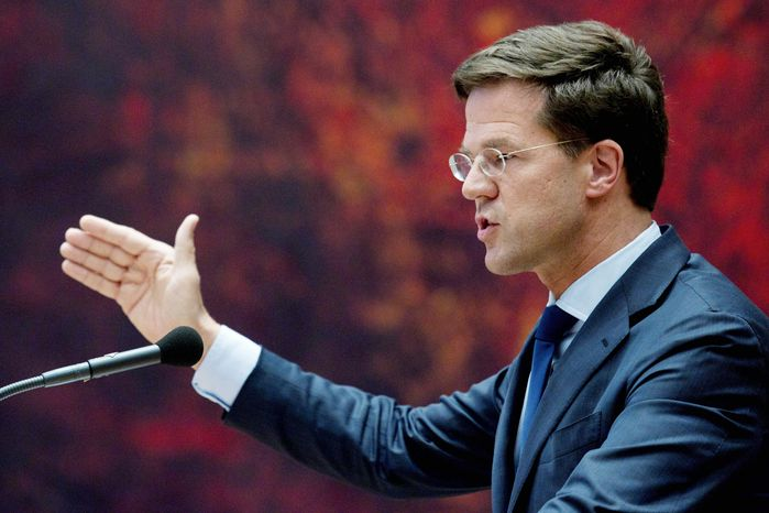 """""""I stand here in the hope that parties in this chamber are prepared ... to do what is necessary to pull the Netherlands through these difficult economic times,"""" caretaker prime minister Mark Rutte tells Parliament on Tuesday. (Associated Press)"""