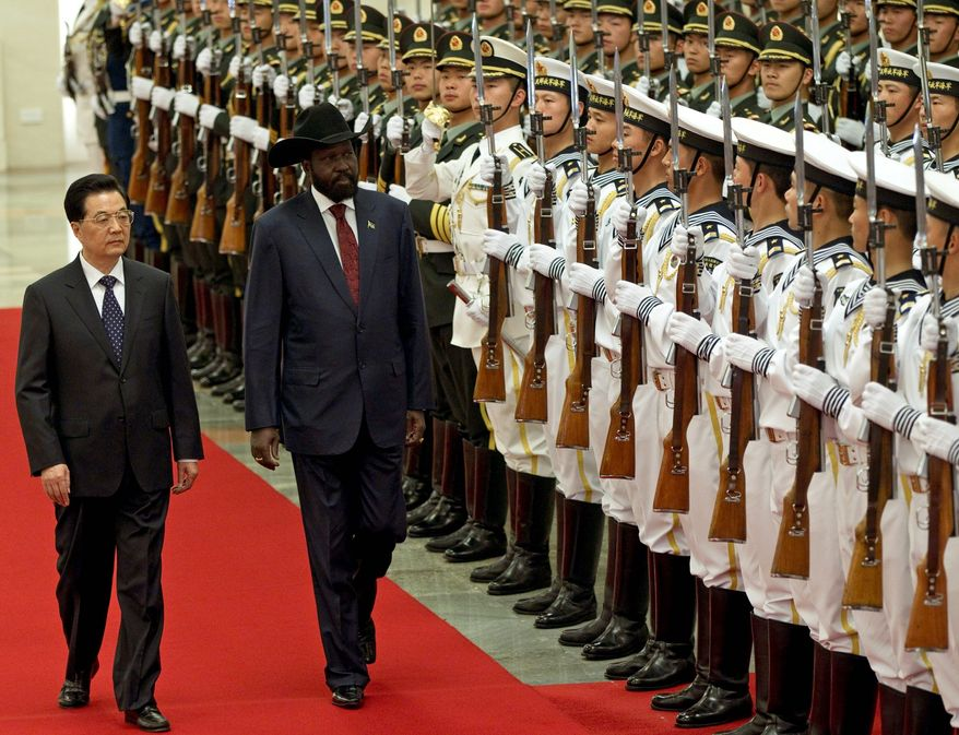South Sudanese President Salva Kiir reviews an honor guard with Chinese President Hu Jintao during a welcoming ceremony at the Great Hall of the People in Beijing. The Obama administration has been working closely with Beijing to try to prevent a full-fledged war between Sudan and South Sudan, where bombs dropped overnight heightened tensions. (Associated Press)