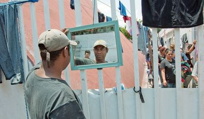 """Sebastian Ponce, 35, from La Ceiba, Honduras, has stopped at the migrant shelter run by the Catholic Church in Tultitlan, Mexico while on his journey to get back into the United States. """"In Honduras, there's no work,"""" he says. (Keith Dannemiller/Special to The Washington Times)"""