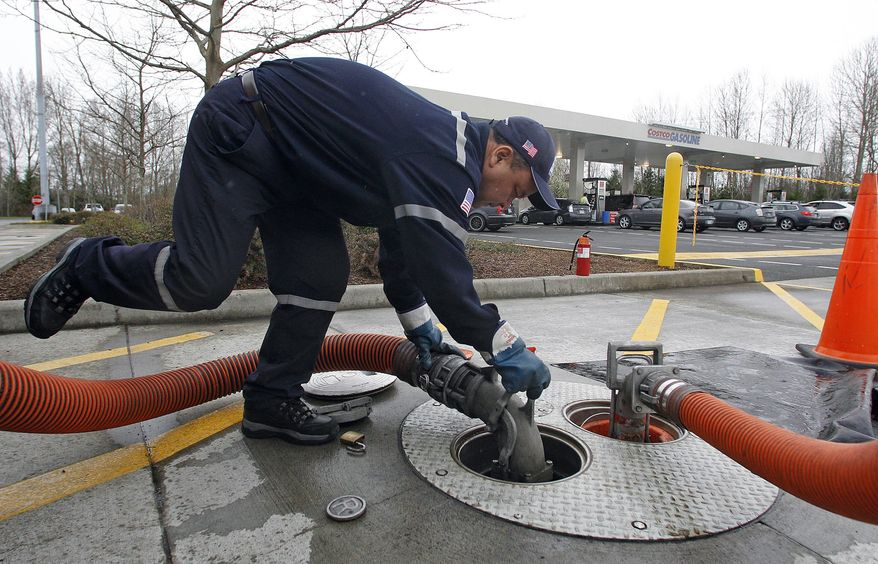 A driver delivers gas to a Costco store on Tuesday, March 27, 2012, in Portland, Ore. (AP Photo/Rick Bowmer)