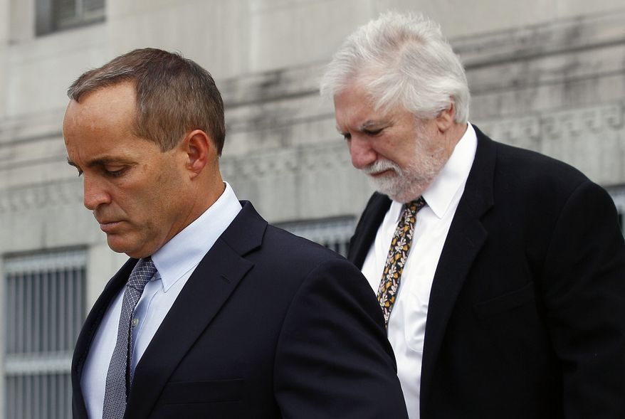 Andrew Young (right), former aide to former U.S. Sen. and presidential candidate John Edwards, leaves federal court April 23, 2012, with attorney David Geneson in Greensboro, N.C. (Associated Press)