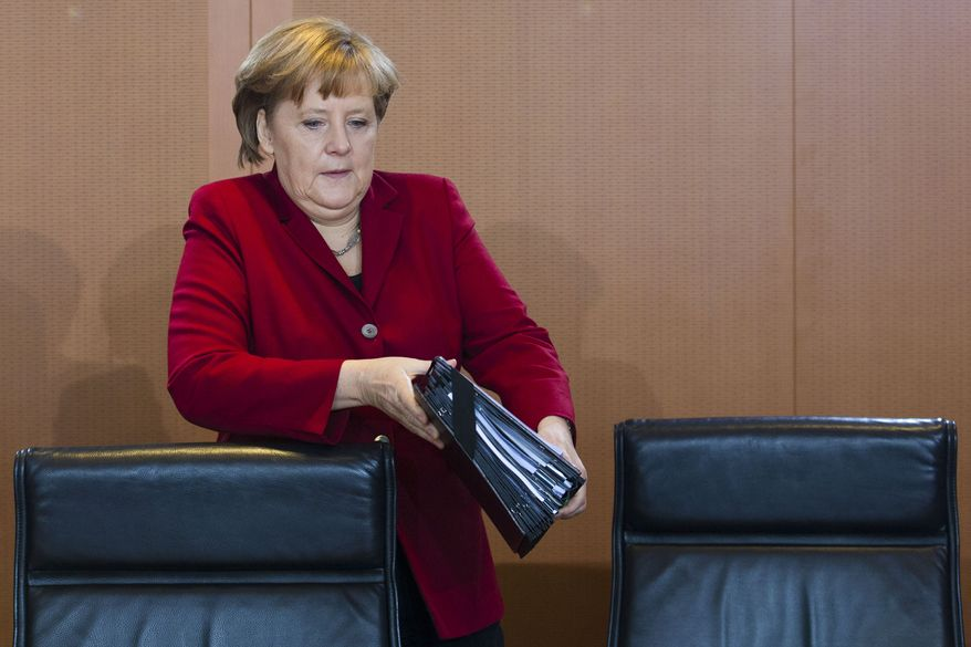 ** FILE ** German Chancellor Angela Merkel arrives at the weekly Cabinet meeting at the Chancellery in Berlin on Wednesday, March 28, 2012. (AP Photo/Markus Schreiber)