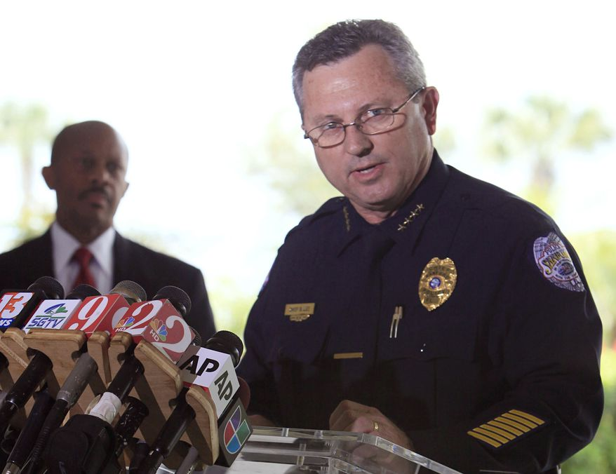 **FILE** Sanford Police Chief Bill Lee speaks to the the media on March 22, 2012, during a news conference in Sanford Fla., as city manager Norton Bonaparte Jr. (left) listens. (Associated Press)