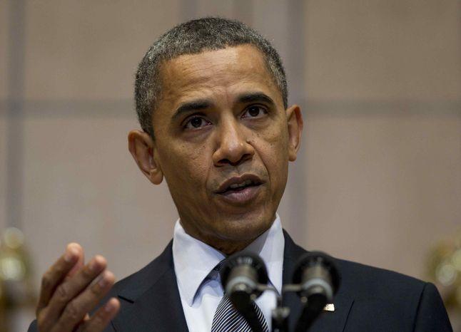 ** FILE ** President Obama (AP Photo/Carolyn Kaster)