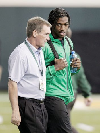 Redskins coach Mike Shanahan and Baylor quarterback Robert Griffin III had a getting-to-know-you session in Waco, Texas, on March 21. (Associated Press)
