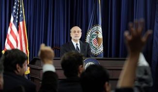 Federal Reserve Chairman Ben S. Bernanke said Wednesday that bond buying and other steps by the Fed are still an option if the economy should weaken. (Associated Press)