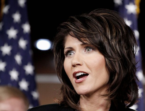 """""""Violence knows no bounds,"""" says Rep. Kristi L. Noem, South Dakota Republican, during a news briefing Wednesday with 11 other GOP women lawmakers. (Associated Press)"""