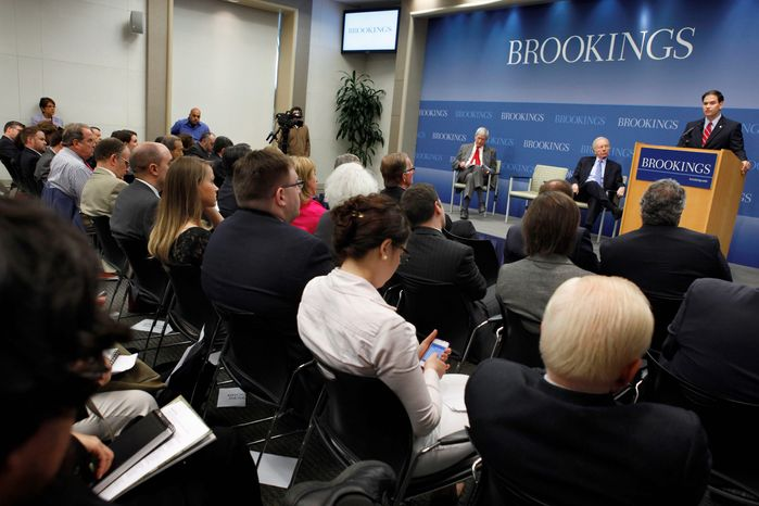 Sen. Marco Rubio of Florida (right) talks about his views on foreign policy at the Brookings Institution in Washington on Wednesday. He is joined by Marvin Kalb (left), a Brookings guest scholar, and Sen. Joe Lieberman, a Democrat-turned-independent from Connecticut. He discussed his views on Iran and Syria. (Associated Press)