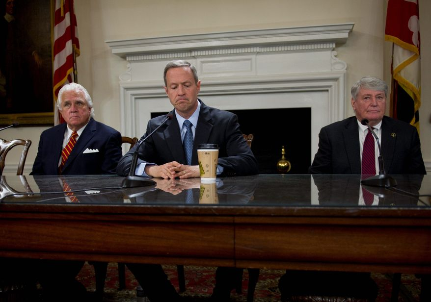 Maryland Gov. Martin O'Malley is flanked by state Senate President Thomas V. Mike Miller Jr. (left) and House Speaker Michael E. Busch during a bill-signing April 10. Mr. O'Malley spoke of his disappointment with the failure to pass a revenue package. (Rod Lamkey Jr/The Washington Times)