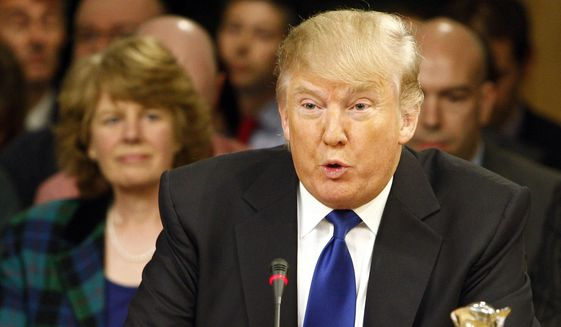 Donald Trump gives evidence April 25, 2012, to the Scottish Parliament's Economy Energy and Tourism Committee in Edinburgh, Scotland. (Associated Press/Scottish Parliament)