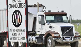 This Tuesday, April 24, 2012, photo shows a truck entering Baker Commodities transfer station, where a cow with mad cow disease was discovered, in Hanford, Calif. (AP Photo/The Fresno Bee, John Walker)
