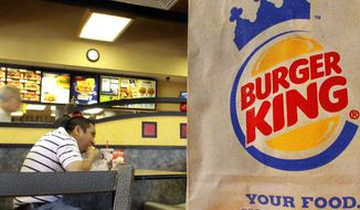 **FILE** Patrons enjoy a meal at a Burger King in Springfield, Ill., on Aug. 24, 2010. (Associated Press)