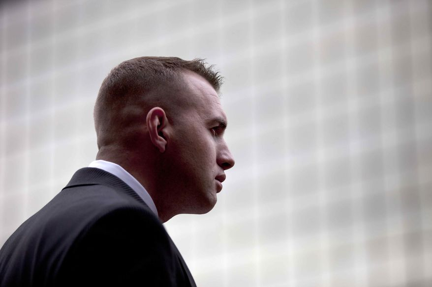 ** FILE ** Marine Sgt. Gary Stein pauses while speaking with reporters in front of the federal court building in San Diego on Friday, April 13, 2012. (AP Photo/Gregory Bull)