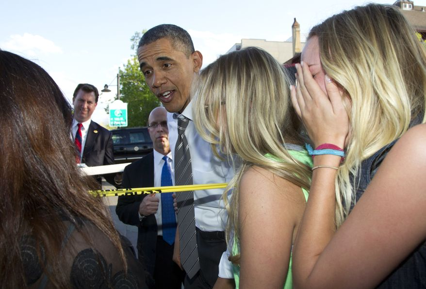 President Obama reacts to having frozen yogurt spilled on his pants as he was greeting the crowd outside the Sink restaurant on Tuesday, April 24, 2012, in Boulder, Colo. (AP Photo/Carolyn Kaster)
