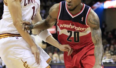 Washington Wizards' Cartier Martin drives past Cleveland Cavaliers' Anthony Parker in the first quarter on Wednesday, April 25, 2012, in Cleveland. (AP Photo/Tony Dejak)