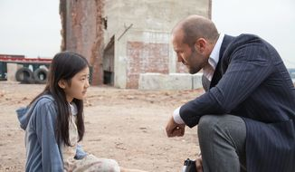 """Jason Statham and Catherine Chan star in the blue-collar action flick """"Safe,"""" which is driven a light plot and heavy dose of action sequences. (Lionsgate via Associated Press)"""