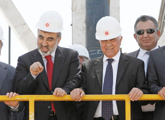 Turkish Energy Minister Taner Yildiz (left) joins Turkish Cypriot leader Dervis Eroglu (second from right) on a drilling platform Thursday to mark the start of exploratory oil and gas drilling by Turkey in the northern half of ethnically split Cyprus. (Associated Press)