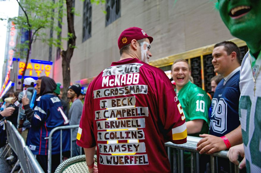Andy Curley of Columbia, Md. shows off his jersey with the long list of quarterbacks that have played for the Washington Redskins quarterbacks with Baylor Quarterback Robert Griffin III listed at the top as he waits in line for the start of the National Football League Draft held at Radio City Music Hall, New York, N.Y., Thursday, April 26, 2012. (Andrew Harnik/The Washington Times)