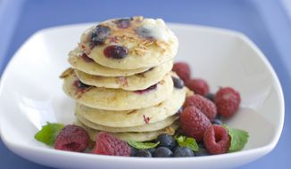 A plate of pancakes with blueberries and granola mixed in the batter is displayed in Concord, N.H. (AP Photo/Matthew Mead)