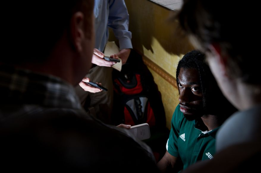 """NFL bound quarterback Robert Griffin III speaks to reporters after unveiling a statue of himself made out of Subway sub """"Smokehouse BBQ Chicken"""" at a Subway sandwich shop in downtown Manhattan, New York, N.Y., Tuesday, April 24, 2012. (Andrew Harnik/The Washington Times)"""