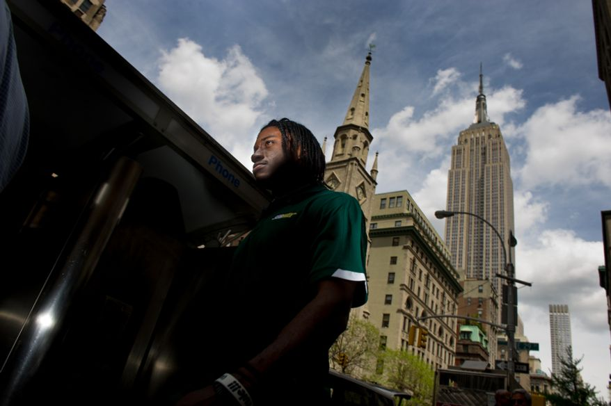 "The Empire State Building can be seen in the skyline, right, as NFL bound quarterback Robert Griffin III departs after unveiling a statue of himself made out of Subway sub ""Smokehouse BBQ Chicken"" at a Subway sandwich shop in downtown Manhattan, New York, N.Y., Tuesday, April 24, 2012. (Andrew Harnik/The Washington Times)"