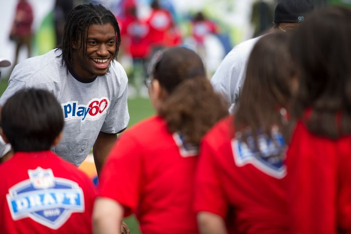 NFL bound quarterback Robert Griffin III, left, and 25 other NFL draft prospects participate in a NFL Play 60 event to help teach the game of football to first through eighth grade New York City students held at Chelsea Waterside Park, New York, N.Y., Wednesday, April 25, 2012. (Andrew Harnik/The Washington Times)