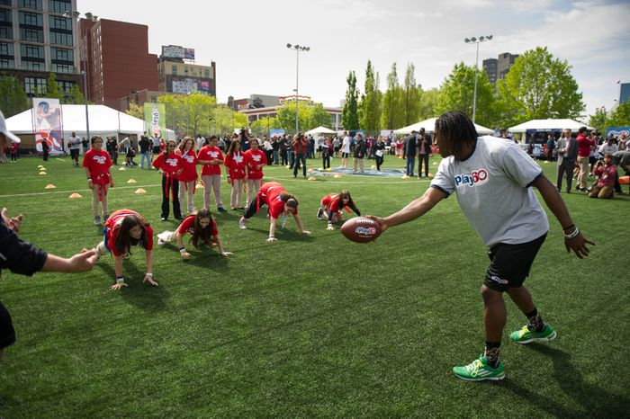 NFL bound quarterback Robert Griffin III, right, and 25 other NFL draft prospects participate in a NFL Play 60 event to help teach the game of football to first through eighth grade New York City students held at Chelsea Waterside Park, New York, N.Y., Wednesday, April 25, 2012. (Andrew Harnik/The Washington Times)