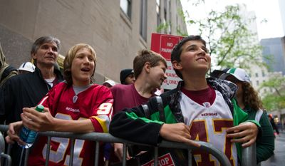 Left to right: Redskin fans Chuck Stafford of Bedford, N.Y. and his three sons Chris, 13, Trant, 14, and Brett, 13 wait for the start of the National Football League Draft held at Radio City Music Hall, New York, N.Y., Thursday, April 26, 2012. (Andrew Harnik/The Washington Times)