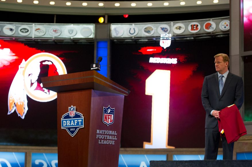 NFL Commissioner Roger Goodell waits on stage with a Redskins Jersey as Baylor quarterback Robert Griffin III is selected by the Washington Redskins as the second pick in the first round of the National Football League Draft held at Radio City Music Hall, New York, N.Y., Thursday, April 26, 2012. (Andrew Harnik/The Washington Times)