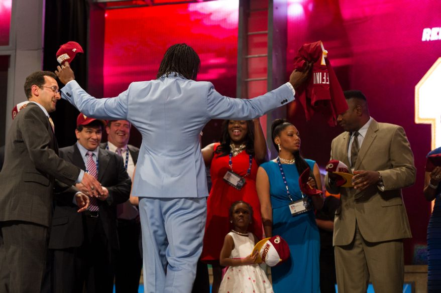 Baylor quarterback Robert Griffin III is greeted on stage by his family as he is selected by the Washington Redskins as the second pick in the first round of the National Football League Draft held at Radio City Music Hall, New York, N.Y., Thursday, April 26, 2012. (Andrew Harnik/The Washington Times)