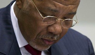 Former Liberian President Charles Taylor looks down as he waits for the start of a hearing to deliver a verdict in the court room of the Special Court for Sierra Leone in Leidschendam, near The Hague, Netherlands, Thursday April 26, 2012. (AP Photo/Peter Dejong, Pool)