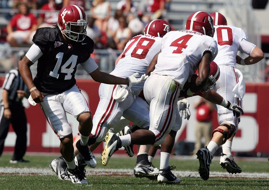 Alabama quarterback Phillip Sims (14) hands the ball off to running back T.J. Yeldon (4) during the second half of the A-Day NCAA spring college football game in Tuscaloosa, Ala., Saturday, April 14, 2012. (AP Photo/The Tuscaloosa News, Michelle Lepianka Carter)