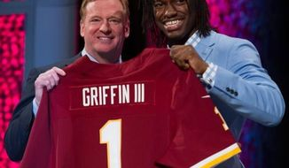 NFL Commissioner Roger Goodell, left, poses with Baylor quarterback Robert Griffin III, right as he is selected by the Washington Redskins as the second pick in the first round of the National Football League Draft held at Radio City Music Hall, New York, N.Y., Thursday, April 26, 2012. (Andrew Harnik/The Washington Times)