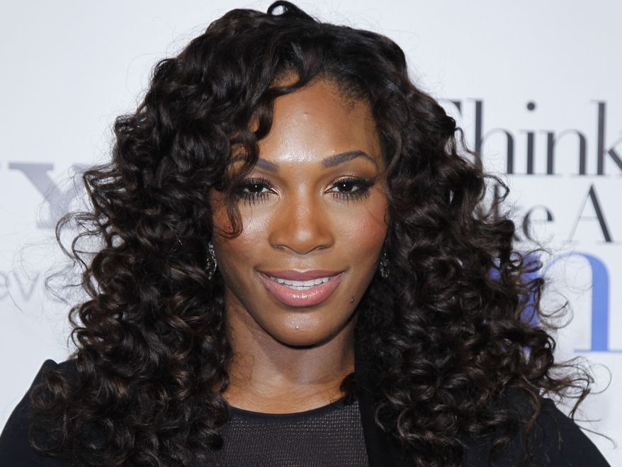 """** FILE ** Tennis player Serena Williams poses at the Pan African Film & Arts Festival's opening-night premiere of Screen Gems' """"Think Like a Man"""" in Los Angeles on Feb. 9, 2012. (AP Photo/Danny Moloshok)"""