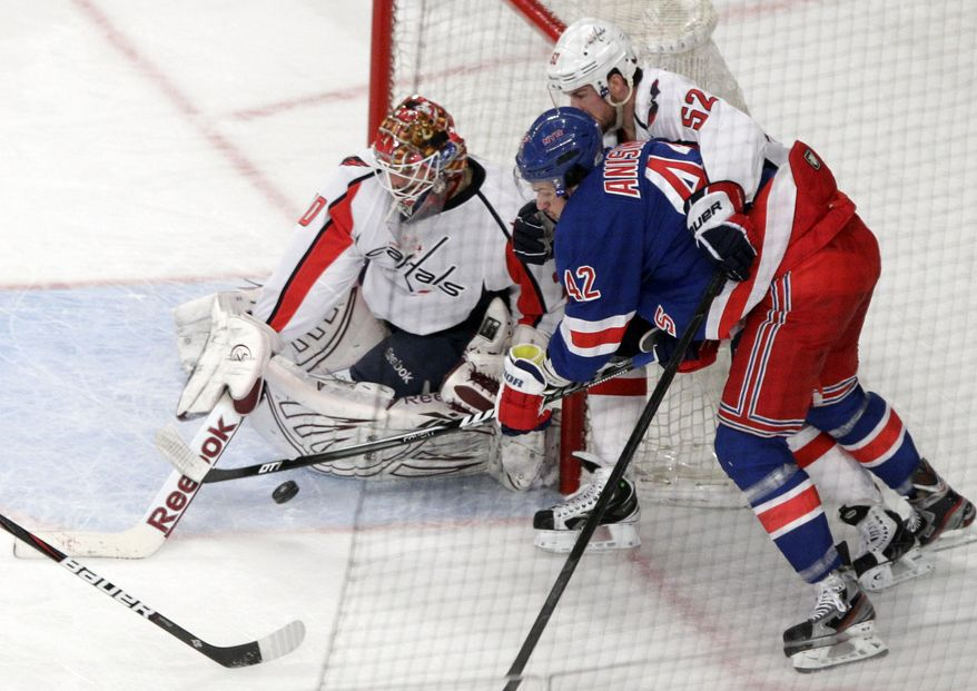 New York Rangers' Artem Anisimov (42) scores a goal past Washington Capitals goalie Braden Holtby (70) as Mike Green helps to defend during the second period of Game 1 in the second round of the NHL hockey Stanley Cup playoffs Saturday, April 28, 2012, in New York. (AP Photo/Frank Franklin II)