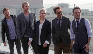 "Cast members from ""The Avengers"" gather on a hotel rooftop in Moscow for a photo shoot. Actors Jeremy Renner, Chris Hemsworth, Scarlett Johansson, Robert Downey Jr., and Mark Ruffalo (from left) play superheroes battling a villain who aims to subjugate humanity. (Associated Press)"