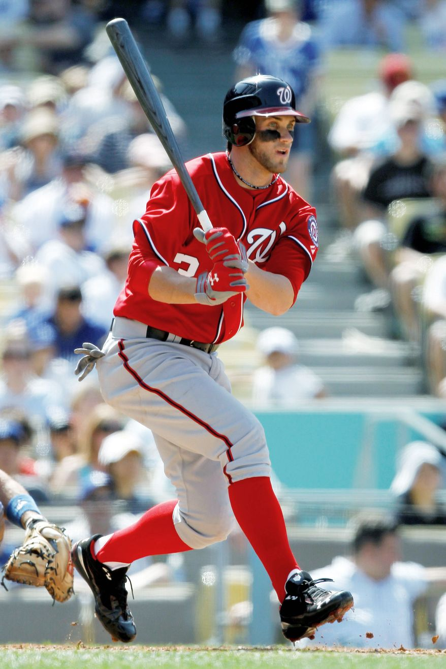 Bryce Harper laces a single for his only hit in Sunday's 2-0 loss to the Los Angeles Dodgers. (Associated Press)