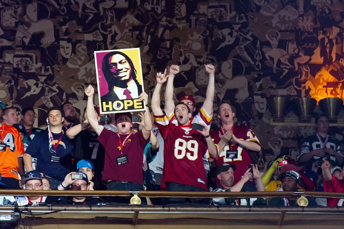 Redsklns fans cast their vote for change when Robert Griffin III's name was announced during Thursday's first round of the NFL Draft. Griffin, the second-overall pick, was last season's Heisman Trophy winner. (Andrew Harnik/The Washington Times)