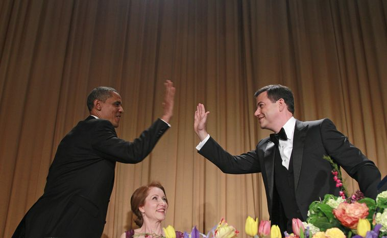 President Obama high-fives late-night comedian Jimmy Kimmel as Caren Bohan, a Reuters journalist and president of the White House Correspondents' Association, watches during the group's annual dinner on Saturday, April 28, 2012, in Washington. (AP Photo/Haraz N. Ghanbari) ** FILE **