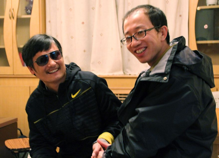 Blind Chinese legal activist Chen Guangcheng (left) meets with fellow activist Hu Jia at an undisclosed location in late April. (AP Photo/Courtesy of Hu Jia)