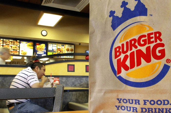A customer chows down at a Burger King in Springfield, Ill. The No. 3 fast-food chain has announced that all of its eggs and pork will come from cage- and crate-free chickens and pigs by 2017, raising the bar for its rivals. (Associated Press)