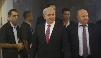 Israeli Prime Minister Benjamin Netanyahu (center) arrives for the weekly Cabinet meeting in Jerusalem on Sunday, April 29, 2012. (AP Photo/Ronen Zvulun, Pool)