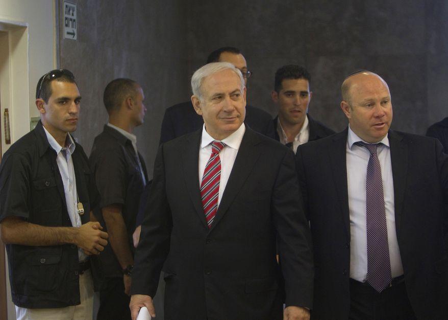 Israeli Prime Minister Benjamin Netanyahu (center) arrives for the weekly Cabinet meeting in Jerusalem on Sunday, April 29, 2012. (AP Photo/Ronen Zvulun, Pool)