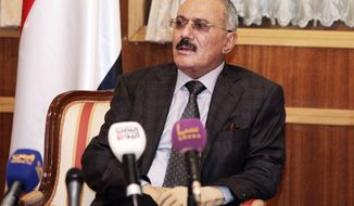 ** FILE ** Then-Yemeni President Ali Abdullah Saleh speaks to state media reporters at the Presidential Palace in Sanaa, Yemen, on Sunday, Jan. 22, 2012. (AP Photo/Office of the Yemeni Presidency)