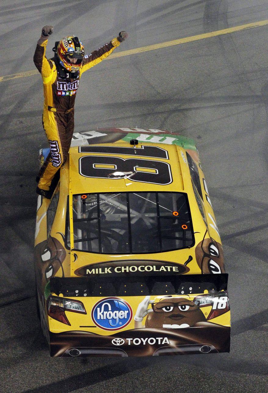 Kyle Busch celebrates winning the NASCAR Sprint Cup Series auto race at Richmond International Raceway in Richmond, Va., on Saturday, April 28, 2012. (AP Photo/Tyler Barrick, Pool)