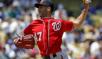 Washington Nationals starting pitcher Gio Gonzalez throws to the Los Angeles Dodgers during the first inning of a baseball game in Los Angeles, Sunday, April 29, 2012. (AP Photo/Chris Carlson)