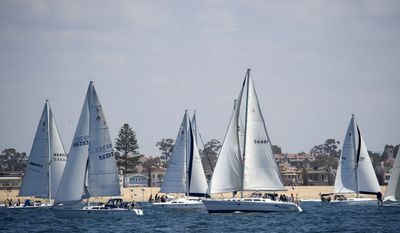 Boats tack for position before the start of the Newport Ocean Sailing Association's Newport-to-Ensenada yacht race on Friday, April 27, 2012, in Corona Del Mar, Calif. (AP Photo/The Orange County Register, Ken Steinhardt)