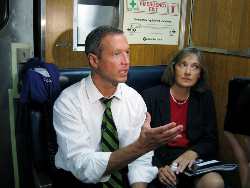 Gov. Martin O'Malley, left, and Maryland Transportation Secretary Beverley Swaim-Staley discuss light rail projects while riding a MARC train in August 2009 (AP Photo/Brian Witte)